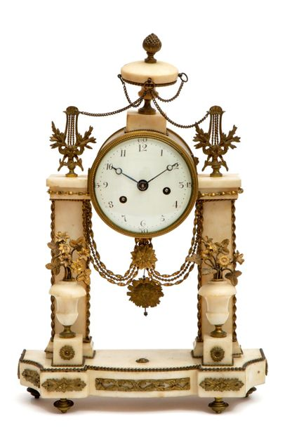 A Directoire white marble and ormolu mantle clock A Directoire white marble and …