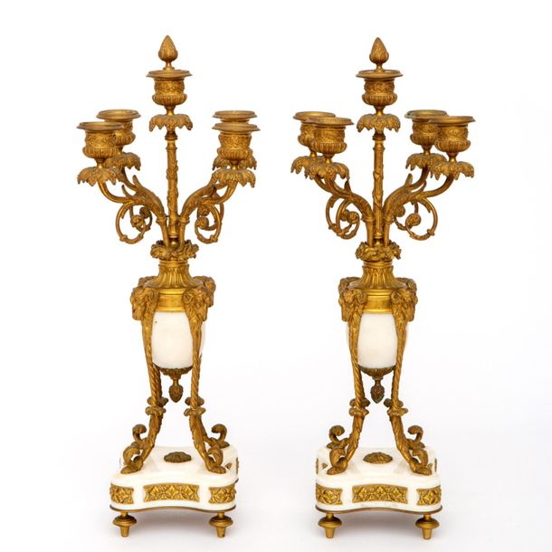 A pair of French ormolu and white marble candelabra A pair of French ormolu and …