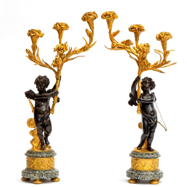 A pair of French gilt and patinated bronze three light figural candle sticks A p…