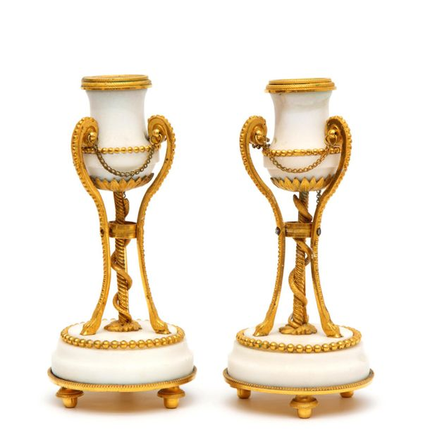 A pair of Louis XVI ormolu and white marble candlesticks A pair of Louis XVI orm…