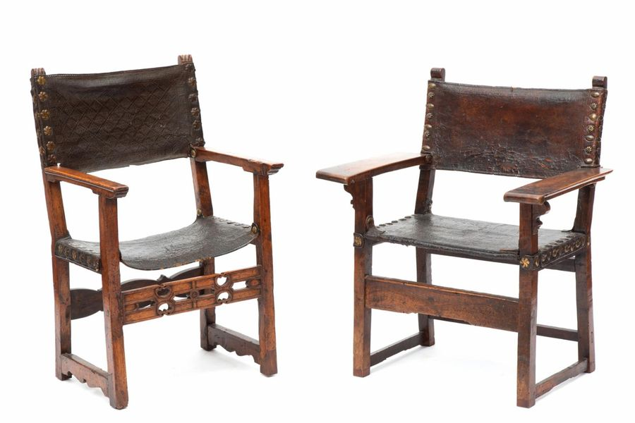 Two Spanish brass mounted walnut and tooled brown leather armchairs Two Spanish …