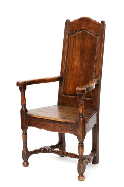 A French elm caquetoire armchair A French elm caquetoire armchair, 18th century,…