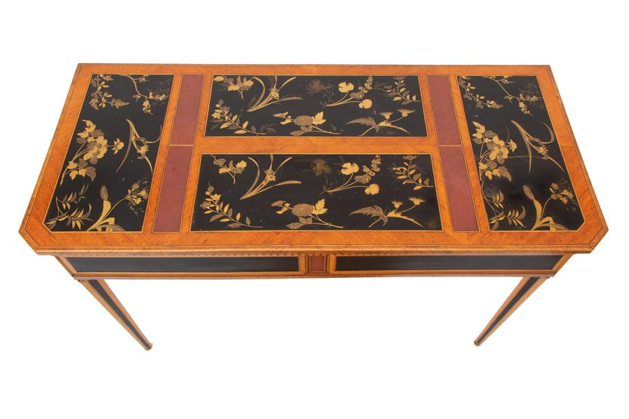 A Dutch satinwood, fruitwood, and red and black and gilt japanned sidetable A Du…