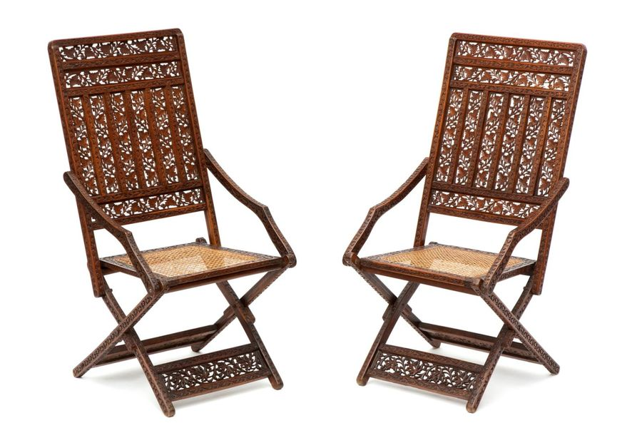 A pair of Portuguese walnut caned folding chairs A pair of Portuguese walnut can…