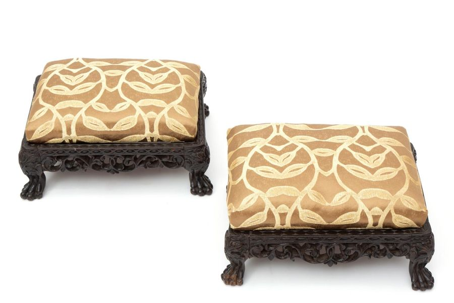 A pair of Dutch colonial hardwood footstools A pair of Dutch colonial hardwood f…
