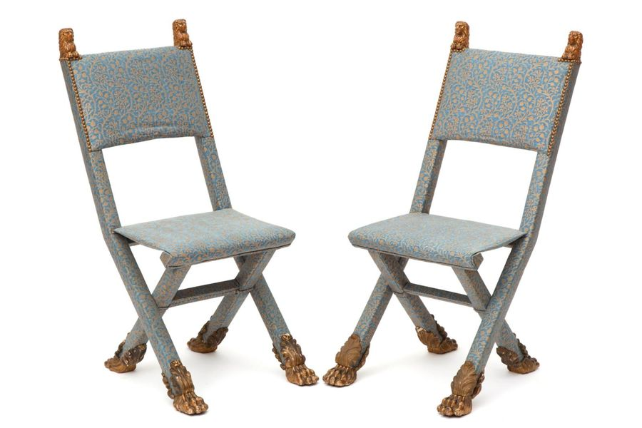 A pair of upholstered folding chairs A pair of upholstered folding chairs, 19th/…