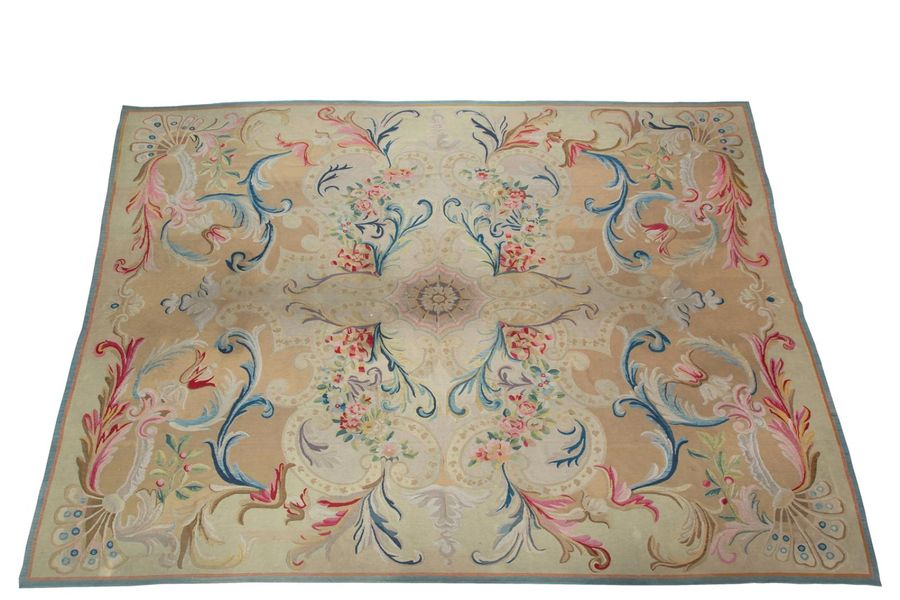 A large Aubusson carpet A large Aubusson carpet, 19th century, France, Decorated…