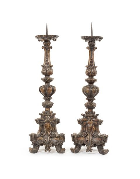 A pair of large late 19th century beechwood carved pricket candlesticks in the 1…