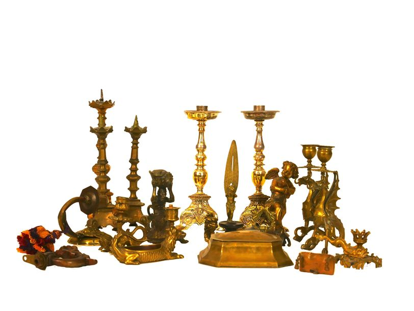 A group of brass and gilt metal candlesticks and decorative objects, mostly 19th…
