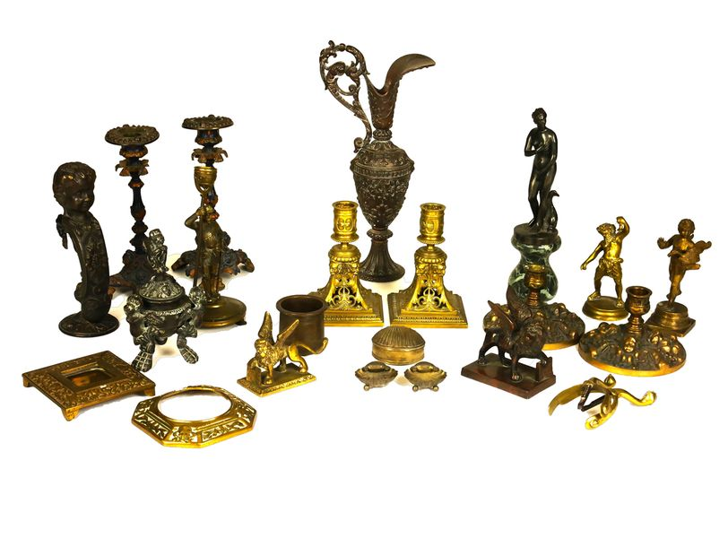 A group of brass and other gilt metal objects and figures A group of brass and o…