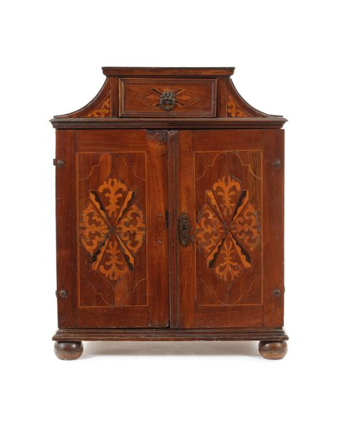 An early 18th century German walnut and sycamore marquetry table cabinet An earl…