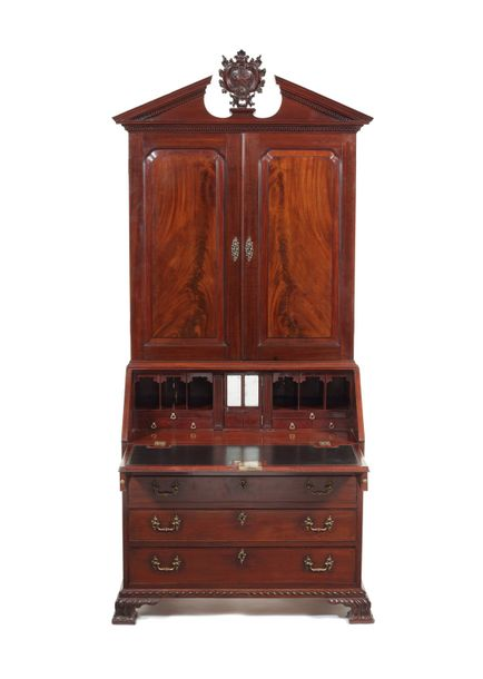 A George II carved mahogany bureau cabinet attributed to Gillows A George II car…
