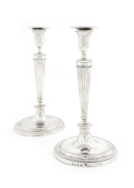 A pair of George III solid silver candlesticks by John Scofield, London, circa 1…