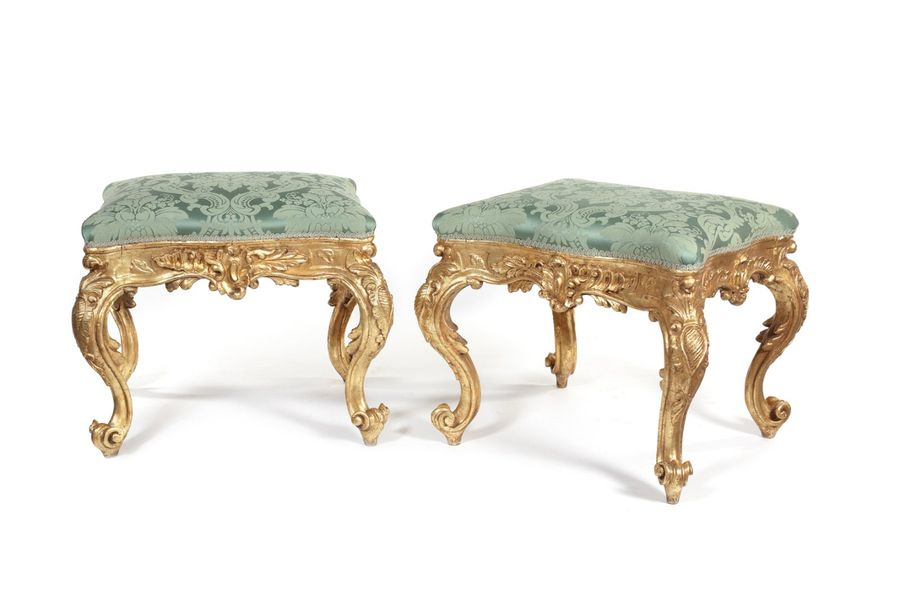 A pair of 19th century Louis XV style carved giltwood serpentine stools A pair o…