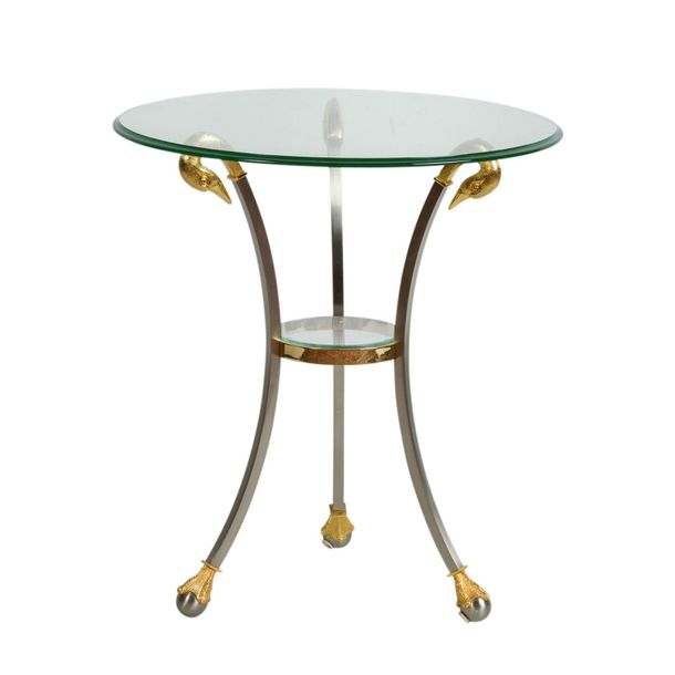 GUERIDON GUERIDON  80s., metal partly gilded, glass top, round top on three curv…