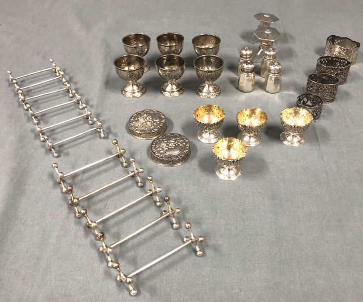 Silver. Also egg cups, knife banks, salt and spice shakers. 1016 grams. Some egg…