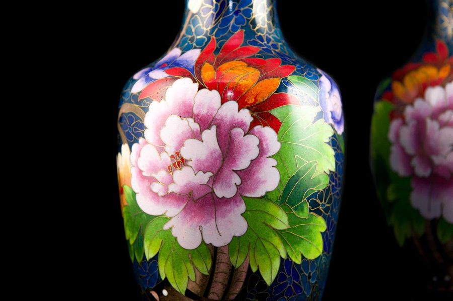Pair of cloisonne vases20th centurydecorated with flowers on a blue background, …