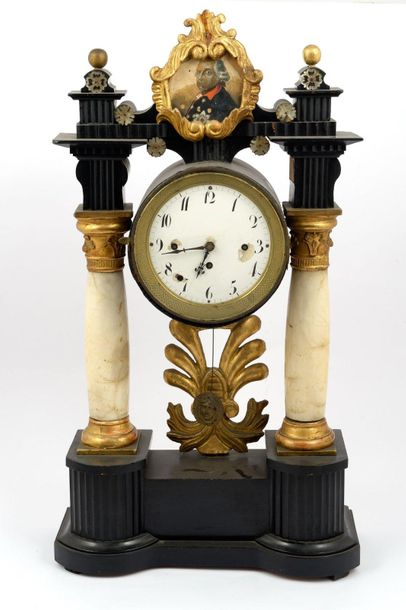 Temple form clock in ebonized wood with alabaster columnsVienna, mid 19th centur…