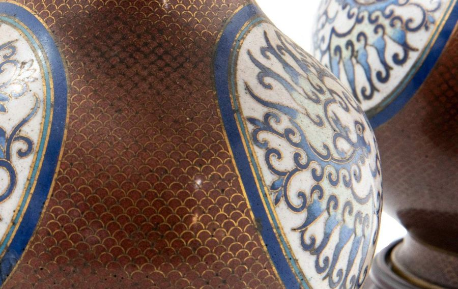 Pair of golden copper vasesChina, early 20th centurydecorated with blue and whit…