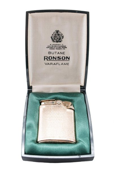 Ronson lighter in gilded metal, in original case, defects and oxidations