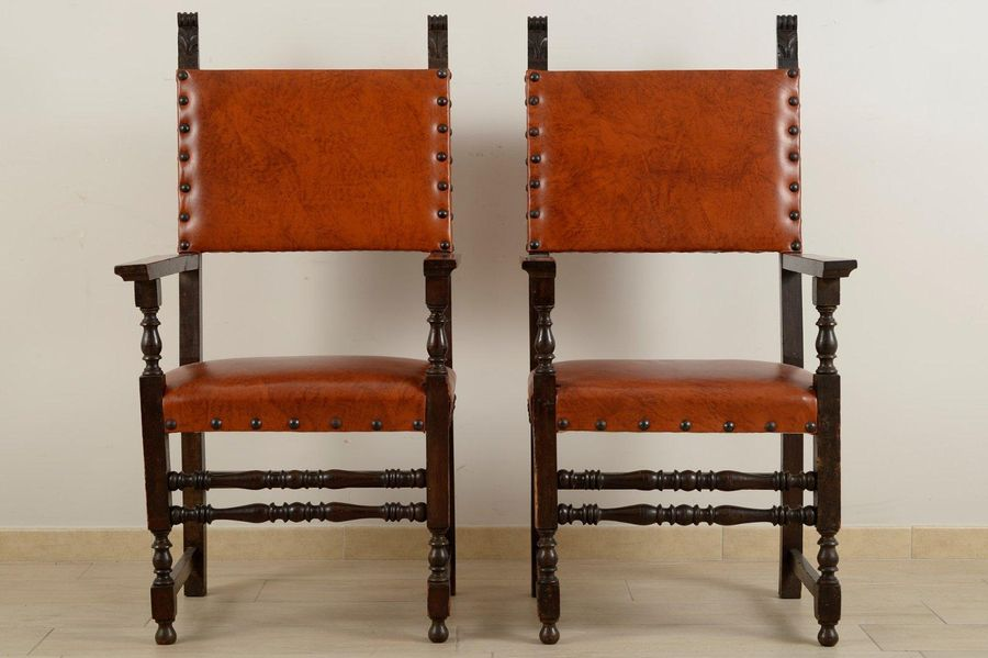 Pair of renaissance style armchairs in ebonized wood with leather paddingItalian…