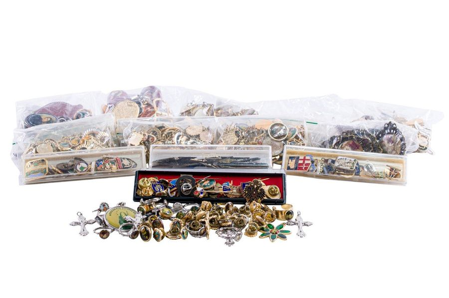 Large collection of brooches and pendants with devotional figures of different s…