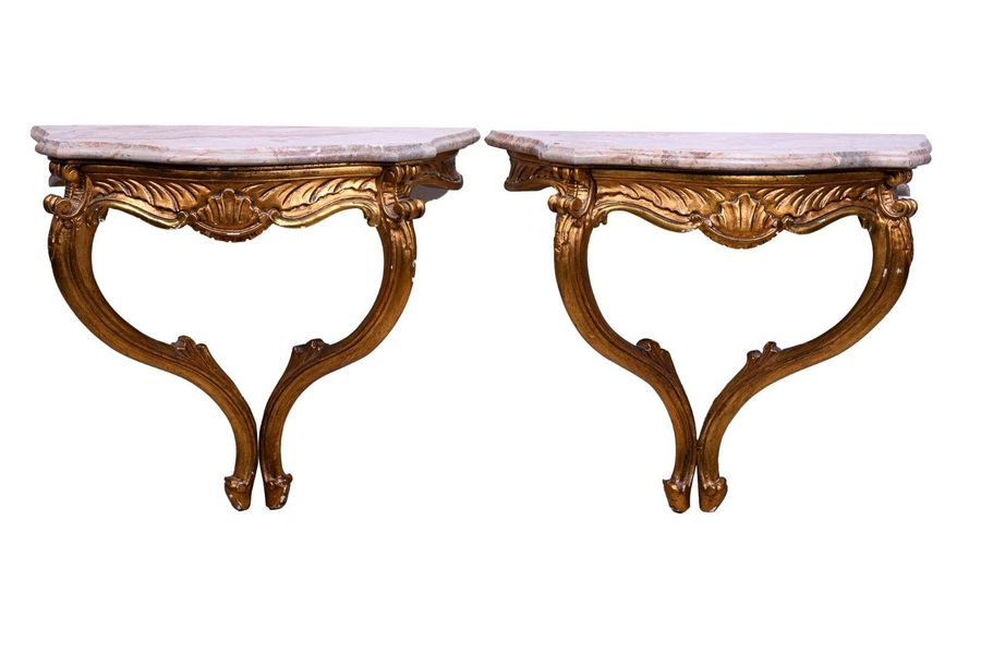 Pair of drop shaped consolesCantù manufacture, mid 20th century with carved unde…