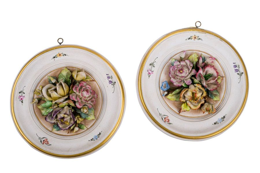 Pair of biscuit porcelain plates20th century central medallion in polychrome flo…