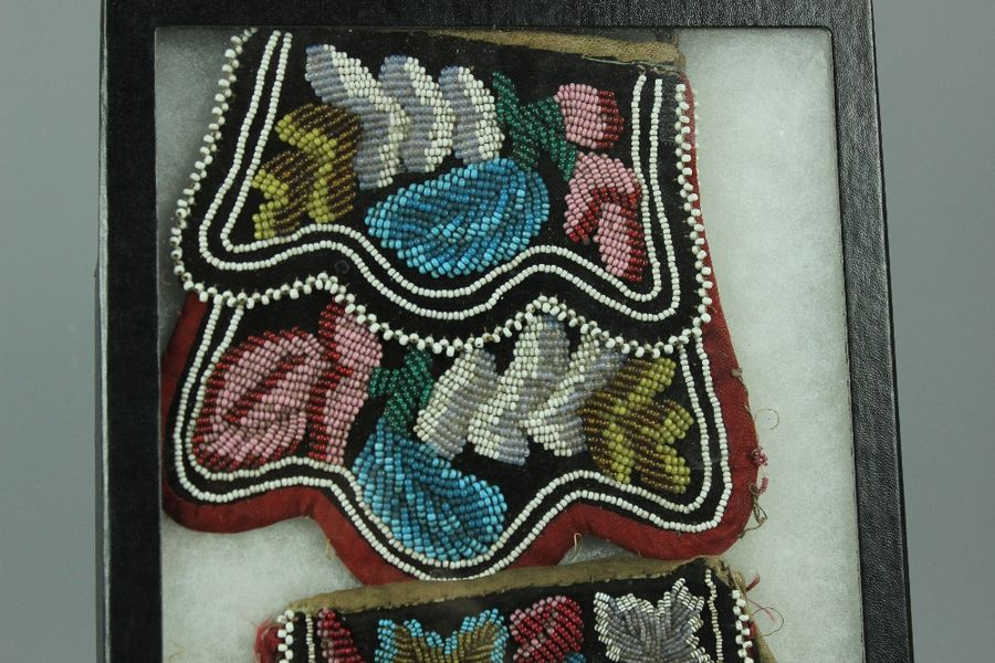 Two North American indigenous Indian beaded purses framed. The frame measures ap…