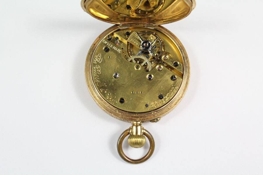 An 18ct yellow gold Continental self winding open faced pocket watch. The watch …