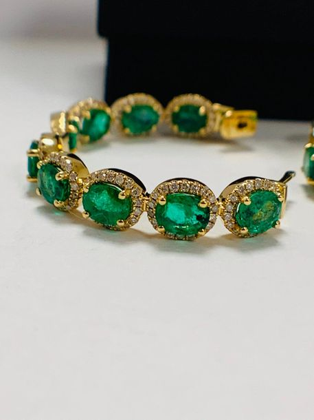 14ct Yellow Gold Emerald and Diamond hoop earrings featuring, 18 oval cut, mediu…