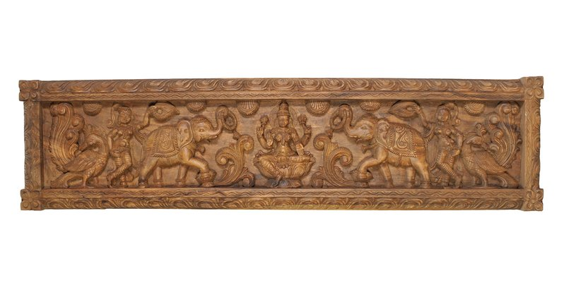 Gajalakshmi Panel Framed in a thick rectangular wooden board with carvings of lo…