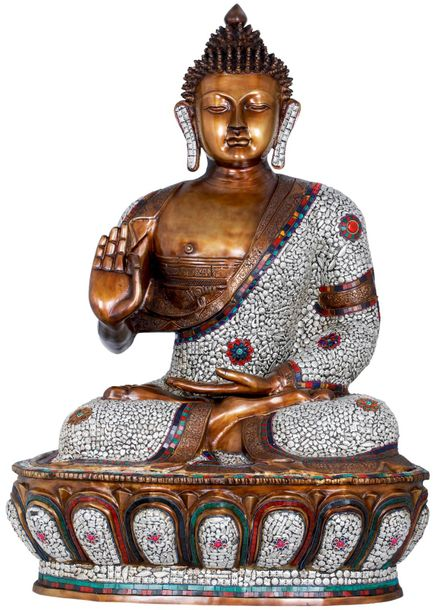 The large inlayed Buddha, carved magnificently sits on a magnified lotus throne …