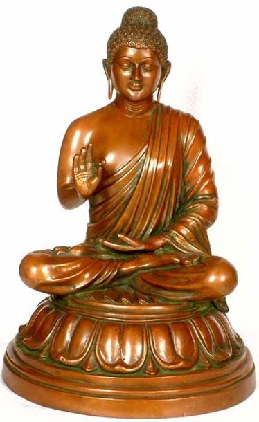 The Buddha, wearing a monastic garb with his right shoulder and arm uncovered, i…