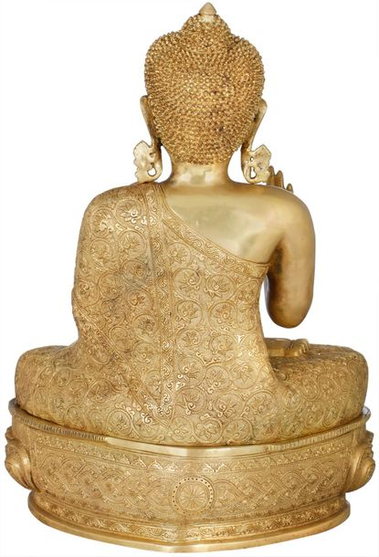 Postured in Padmasana on the richly carved lotus pedestal takes us towards the e…