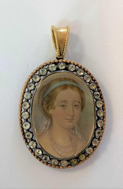 The oval painting depicting Eugénie as a young woman with a blue ribband in her …