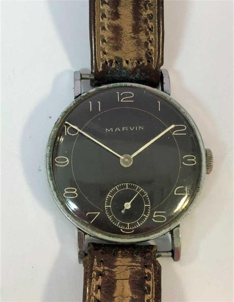 C1950, the signed chocolate brown dial, 37mm diameter, with cream Arabic numeral…