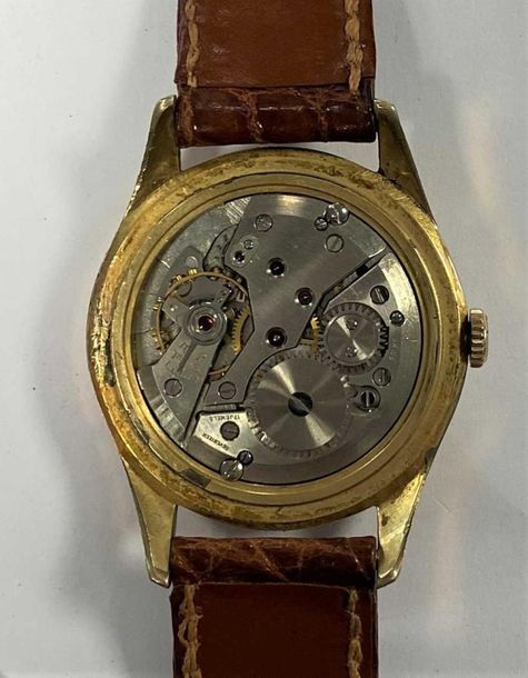C1950, the signed silvered waffle dial, 30mm diameter, with gold coloured altern…