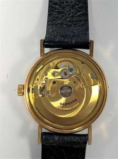 C1990, the signed silvered dial, 30mm diameter, with gold coloured Arabic numera…