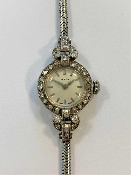 C1955, the cream coloured dial, 14mm diameter, with silver coloured batons and h…