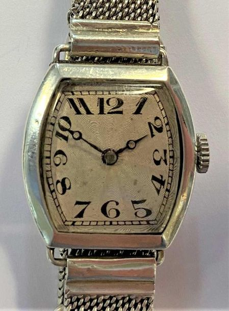 C1927, the tonneau shaped cream coloured dial, 18mm diameter, with starburst eng…