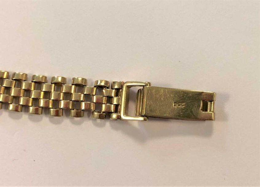C1950, the signed silvered dial, 20mm diameter, with gold coloured batons and ha…