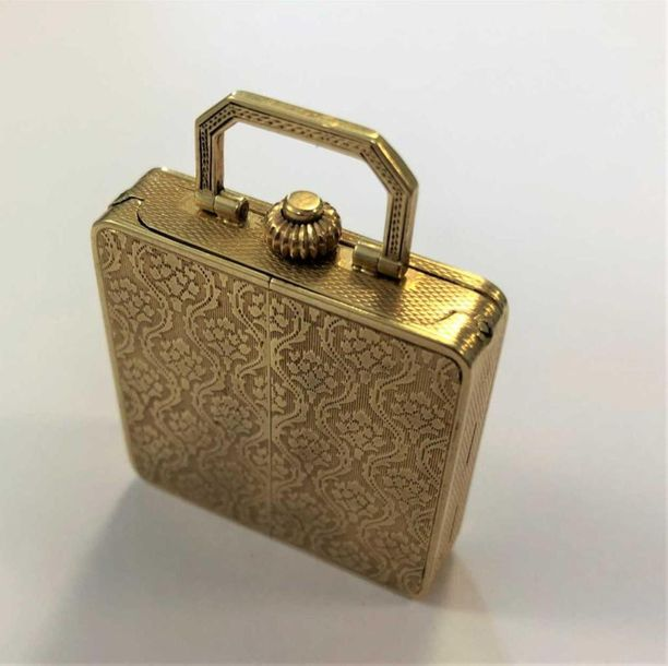 The body of square form resembling a handbag and decorated all over with polishe…