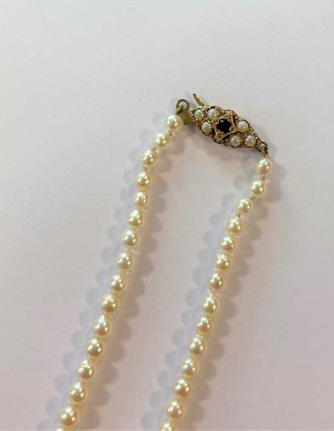 The first, a string of cultured pearls graduating from 3.5 to 7mm, yellow metal …