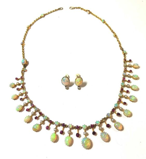 The necklace with central section set of alternate graduated opals and rubies, t…