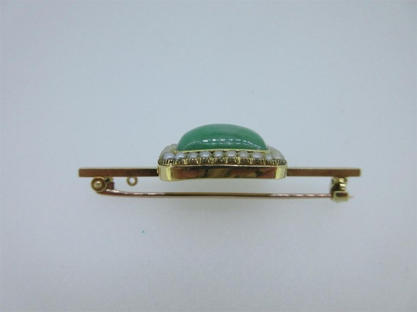 The rectangular cabochon jade collet set to a seed pearl border, the back engrav…