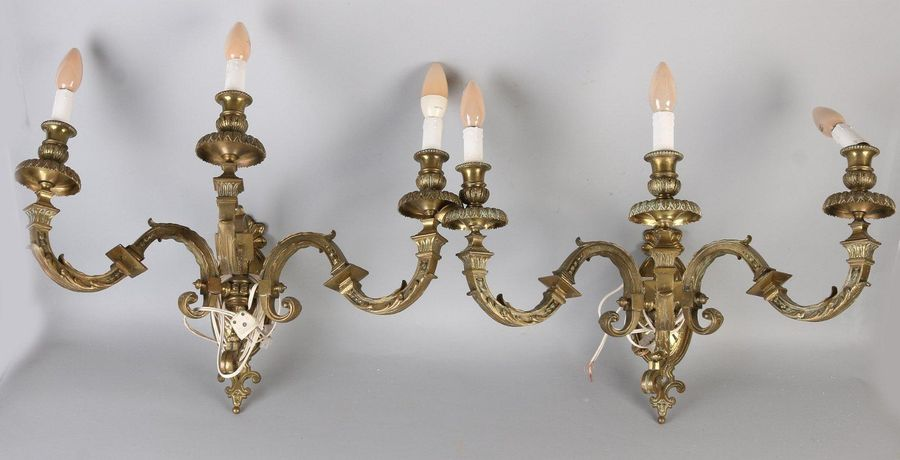 2x Large wall lamps Two large gold plated three arm bronze wall lamps in Louis S…