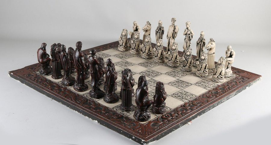 Ancient chess set with Greek figures.Figures, composition, chessboard some dama…