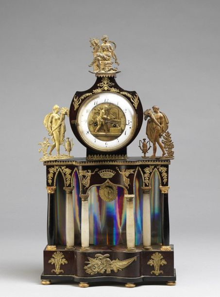 VENETO XIXth CENTURY VENETO XIXth CENTURY Temple table clock, with columns in al…