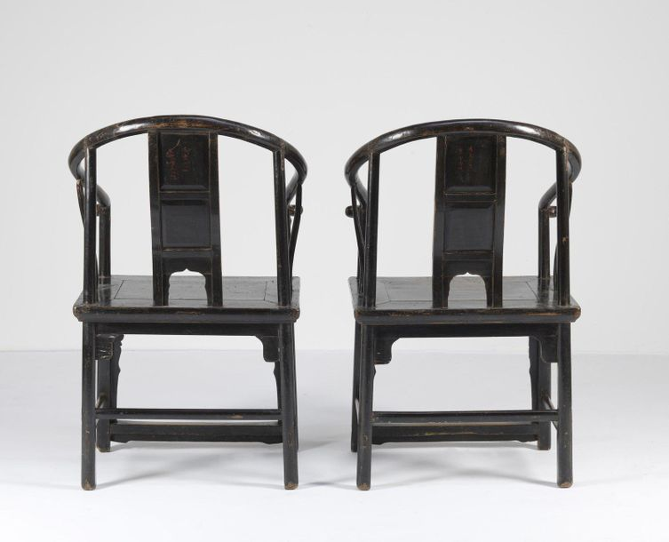 Chinese Art. A pair of wood horse shoe back armchairs decorated with auspicious …